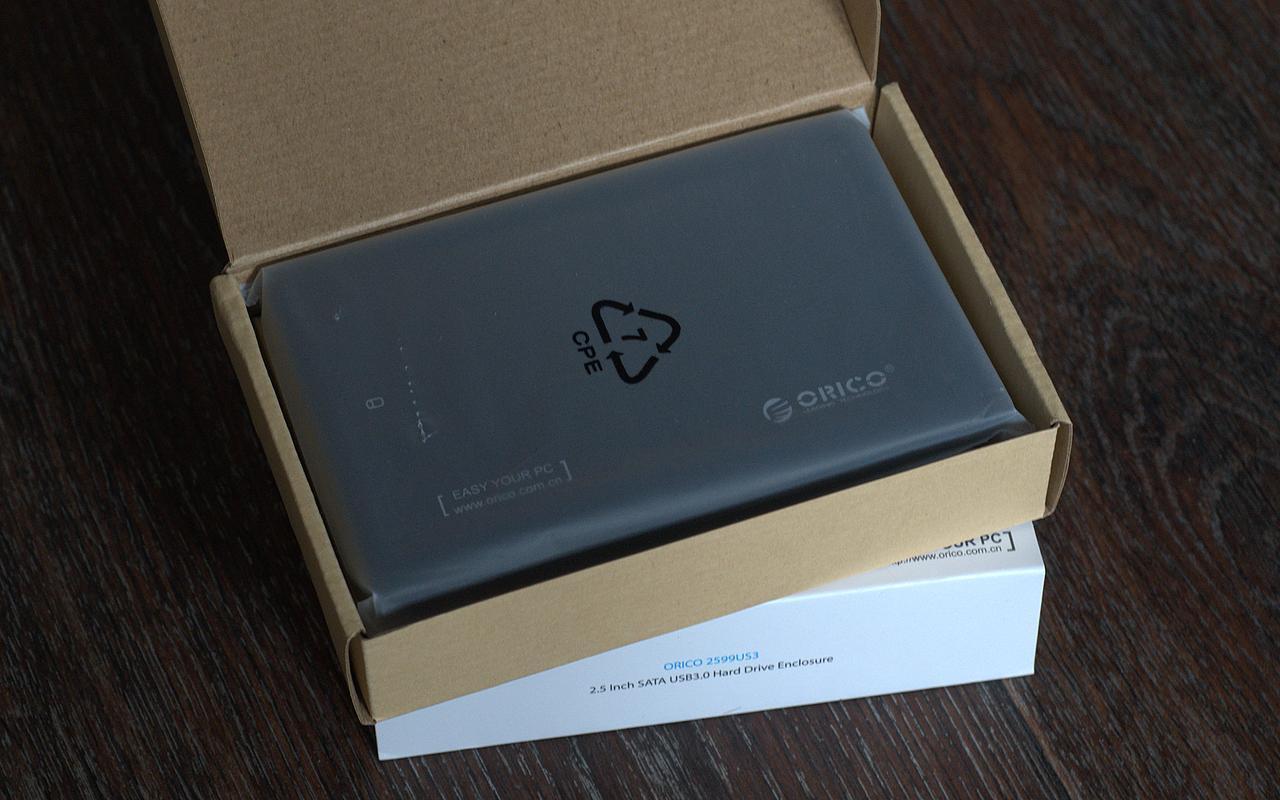 Бокс Orico в пакете внутри картонной упаковки